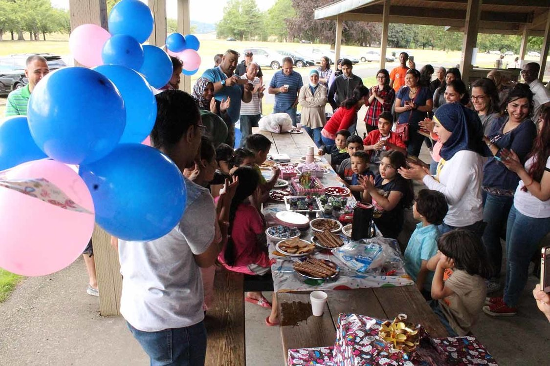 Iraqi refugees celebrate a birthday at Blue Lake Regional Park
