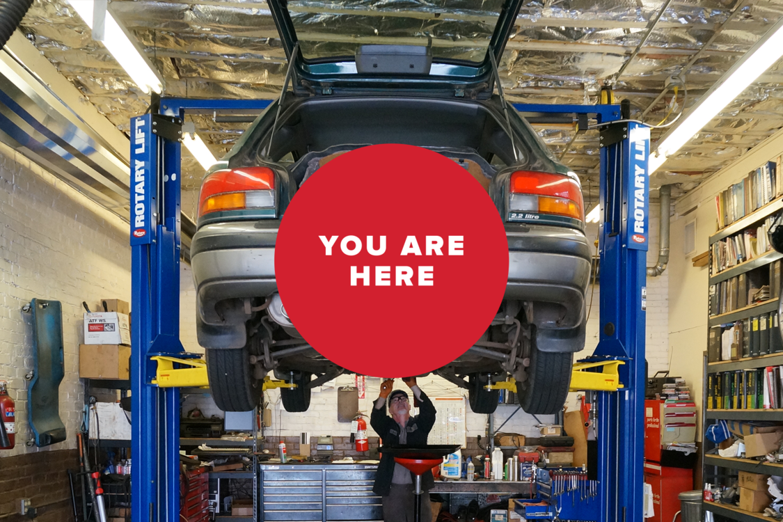 You are here: Man fixing car