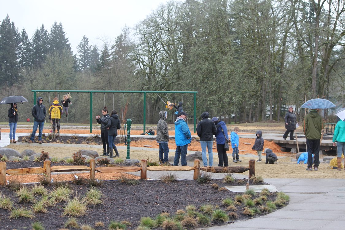 photo of people near the playground structure at Orenco Woods Nature Park