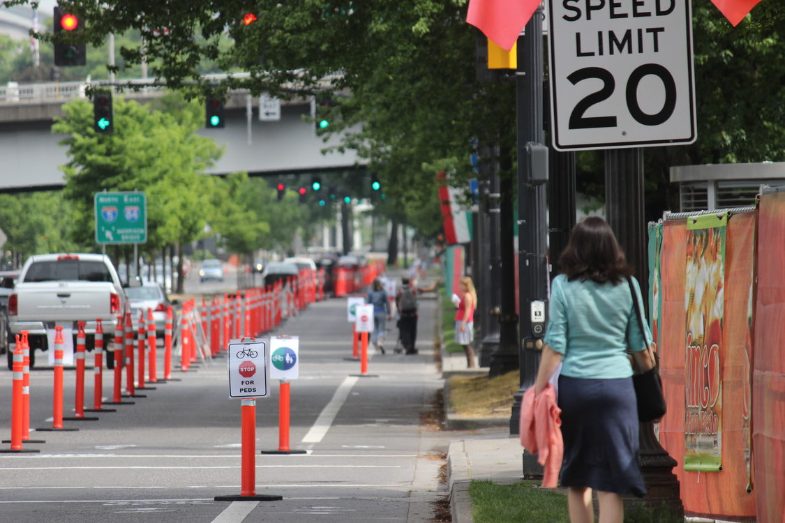 photo of a lane on Naito Parkway converted to open space for the public to walk and bike safely during Better Naito