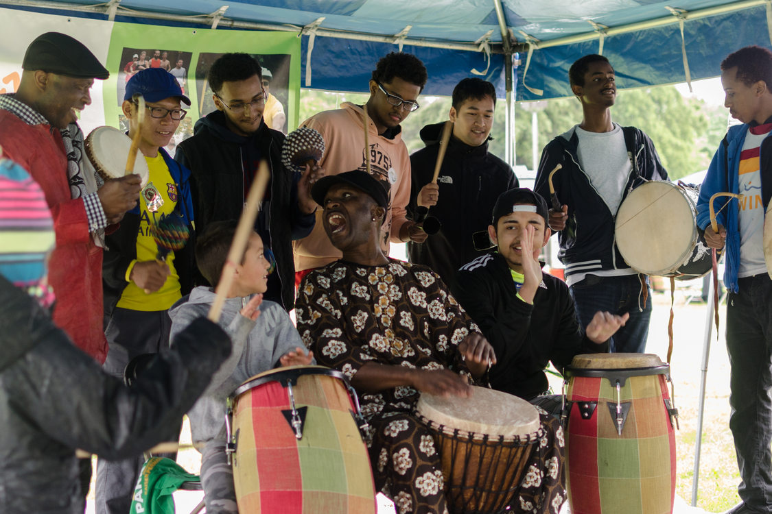 photo of participants playing drums at Sunday Parkways