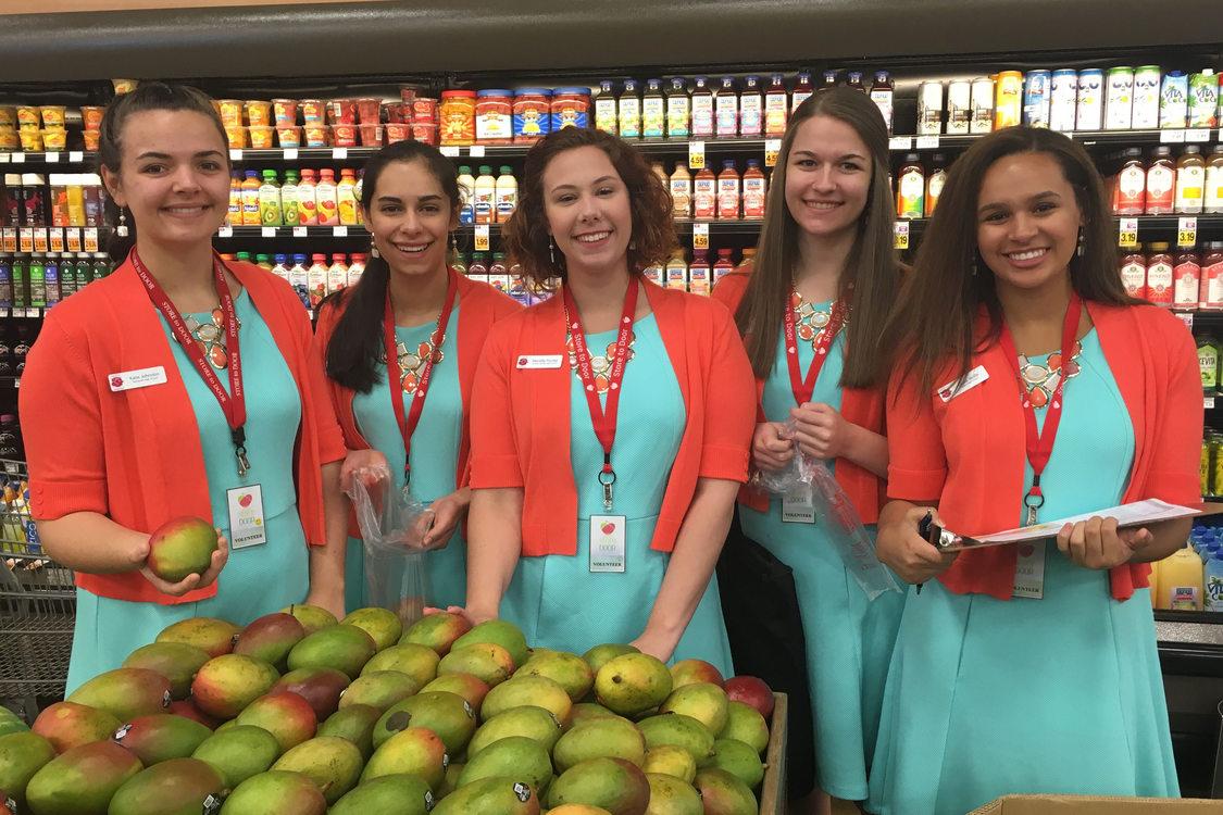 volunteers shop for groceries