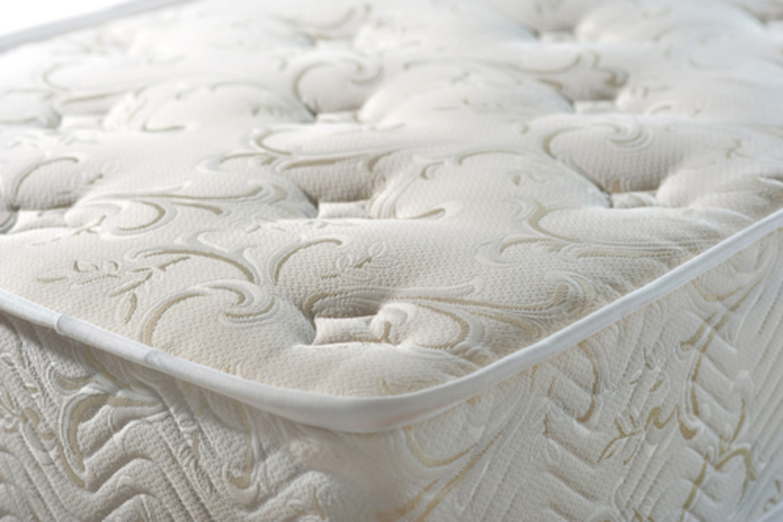 angled view of a padded mattress