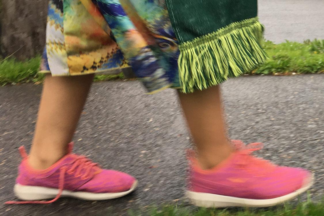 Wide photo of kids feet