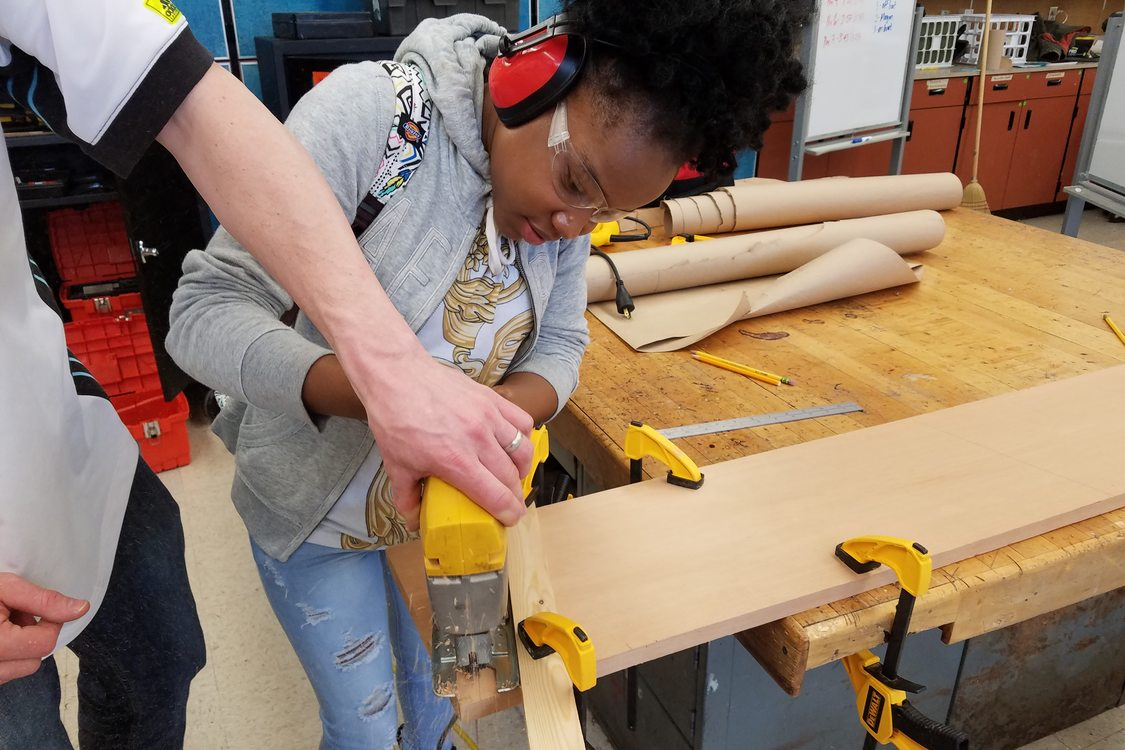 photo of George Middle School student building a boat