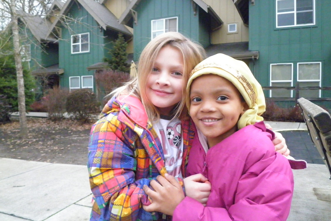 photo of two girls outside Oleson Woods apartments