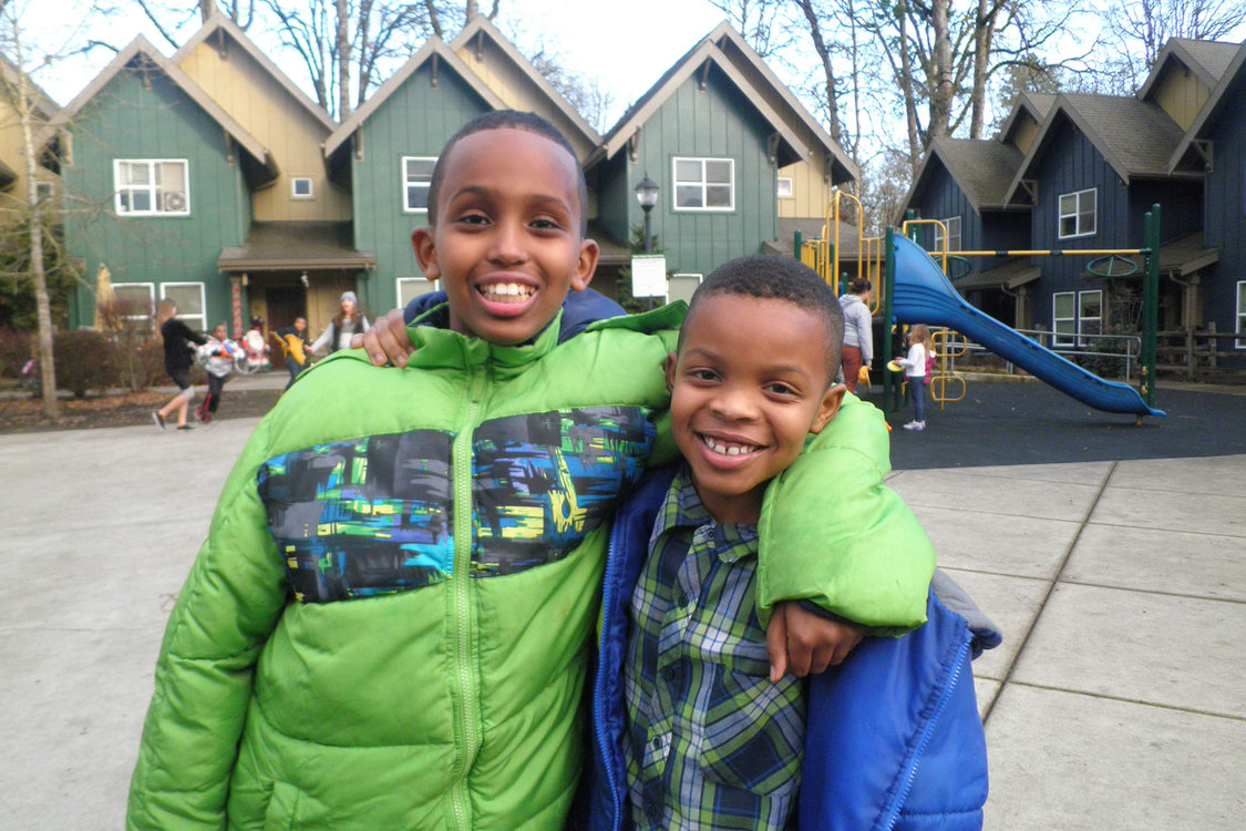 photo of two boys outside Oleson Woods apartments