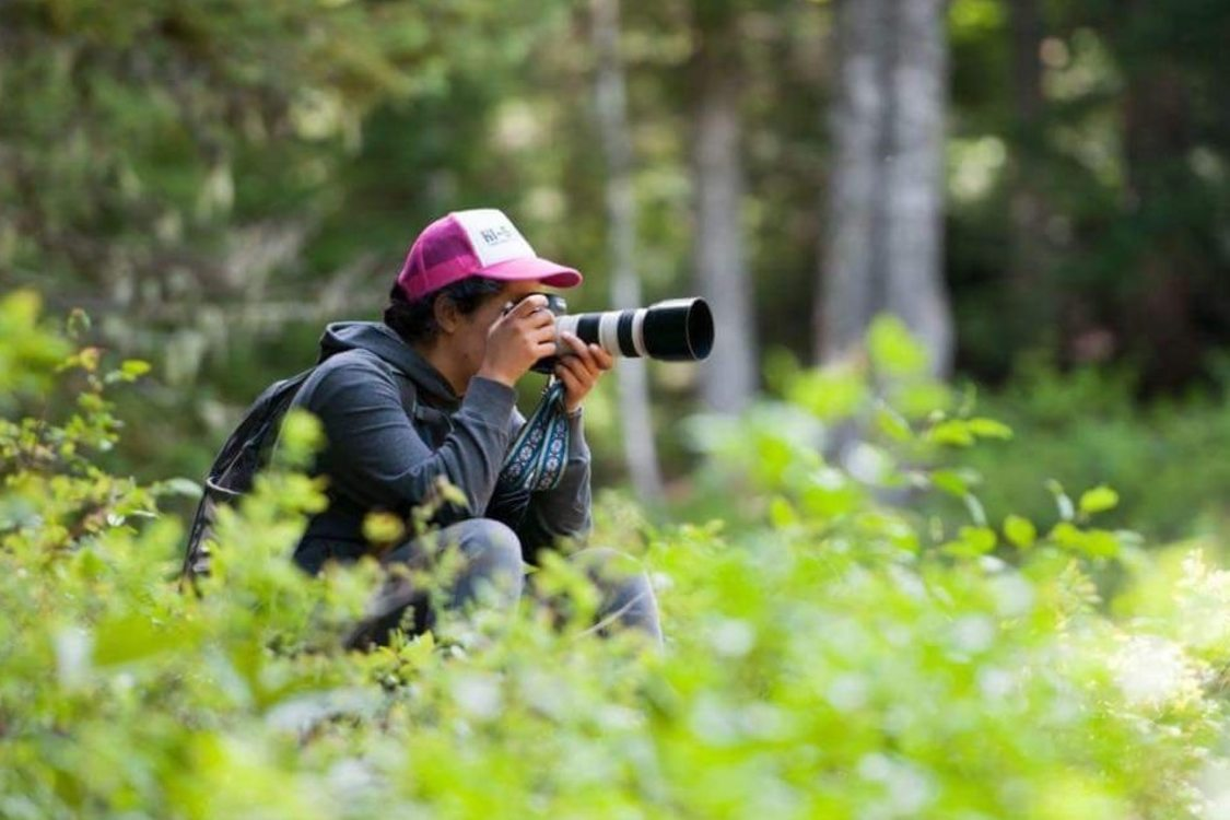 Nature photographer taking photos in a forested location