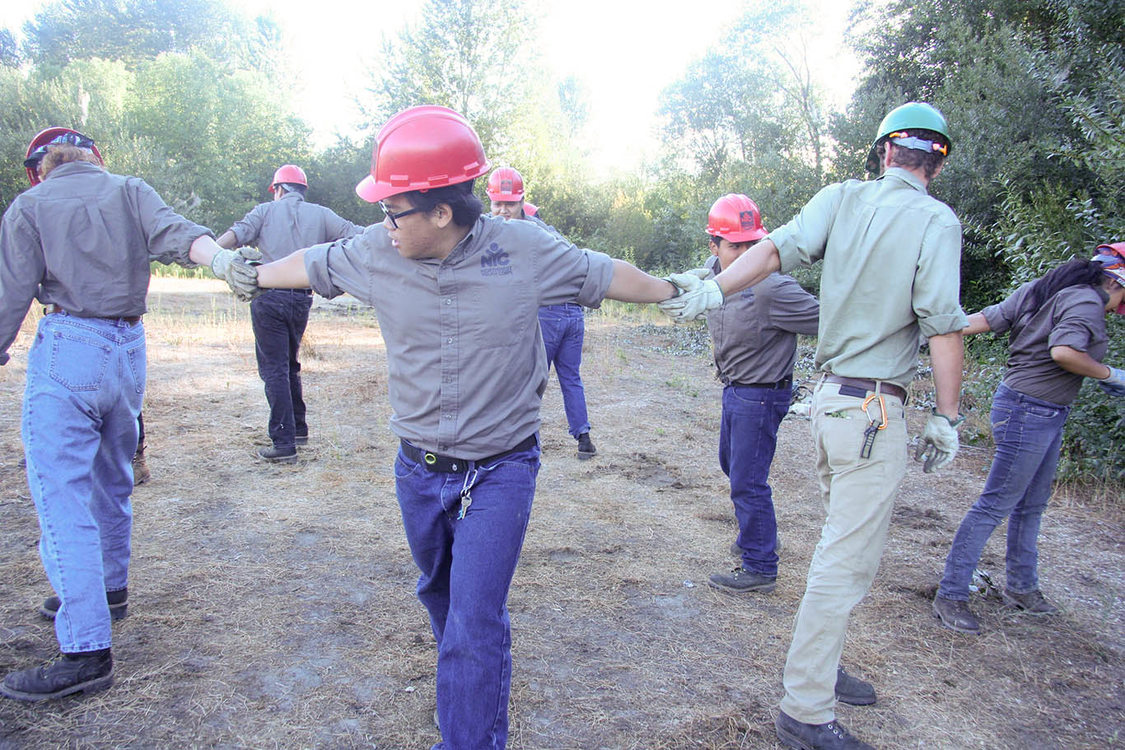 work crew engaging in team-building exercise together