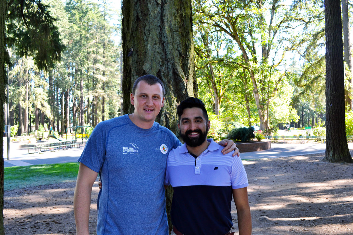 photo of Mike Skuja, outgoing executive director of Tualatin Riverkeepers, and Juan Carlos Gonzalez, development director at Centro Cultural in Shute Park