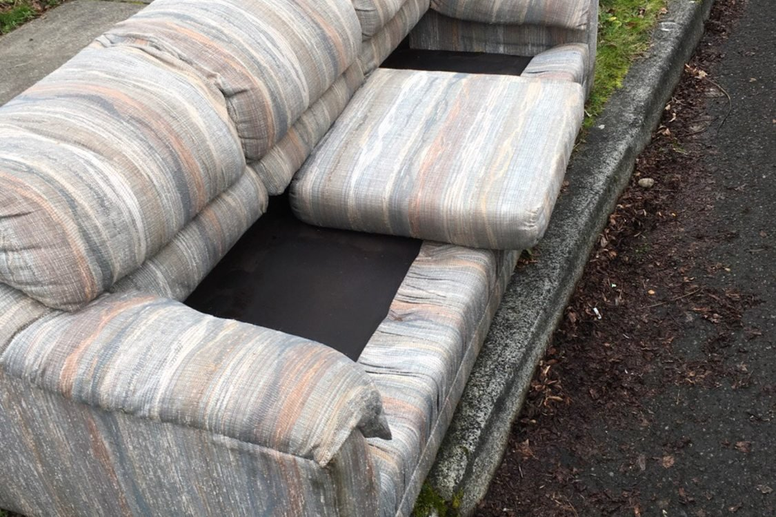 couch on curb missing cushions