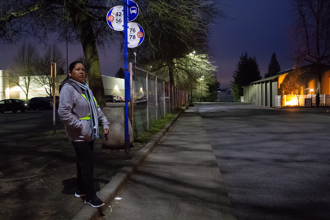 A portrait of Manuela Martinez Espinoza waiting for her bus on an early Saturday morning.
