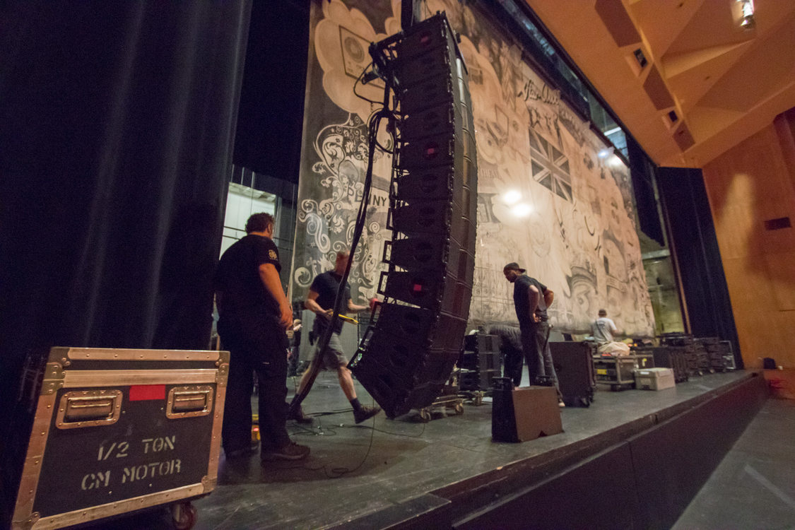 RAIN crew work on hanging speaker systems