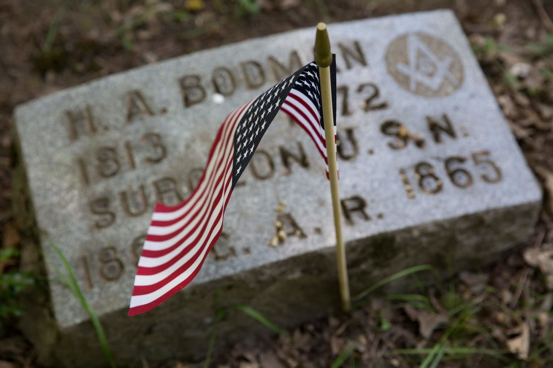 American flag placed at grave on Memorial Day