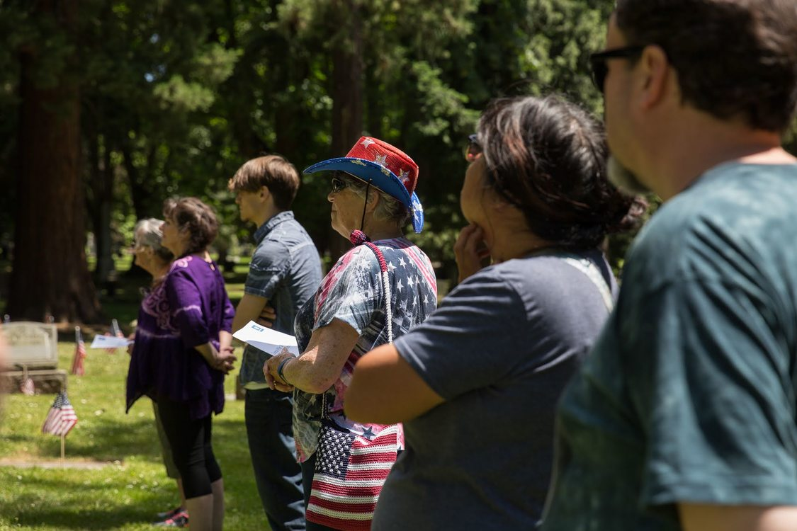 People gathered at Lone Fir Cemetery on Memorial Day