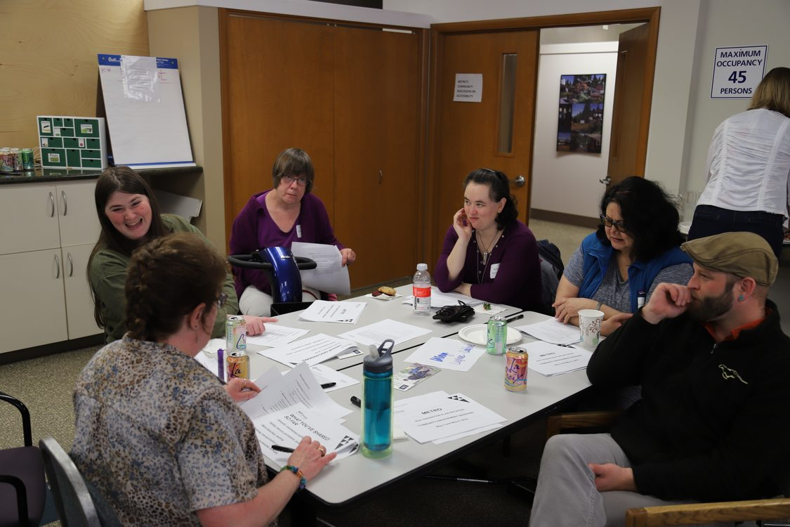Portland disability community members engage in small group discussion