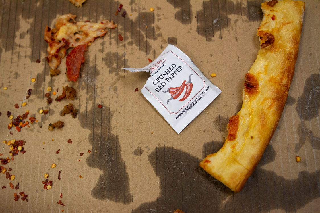 image of a used greasy cardboard pizza box