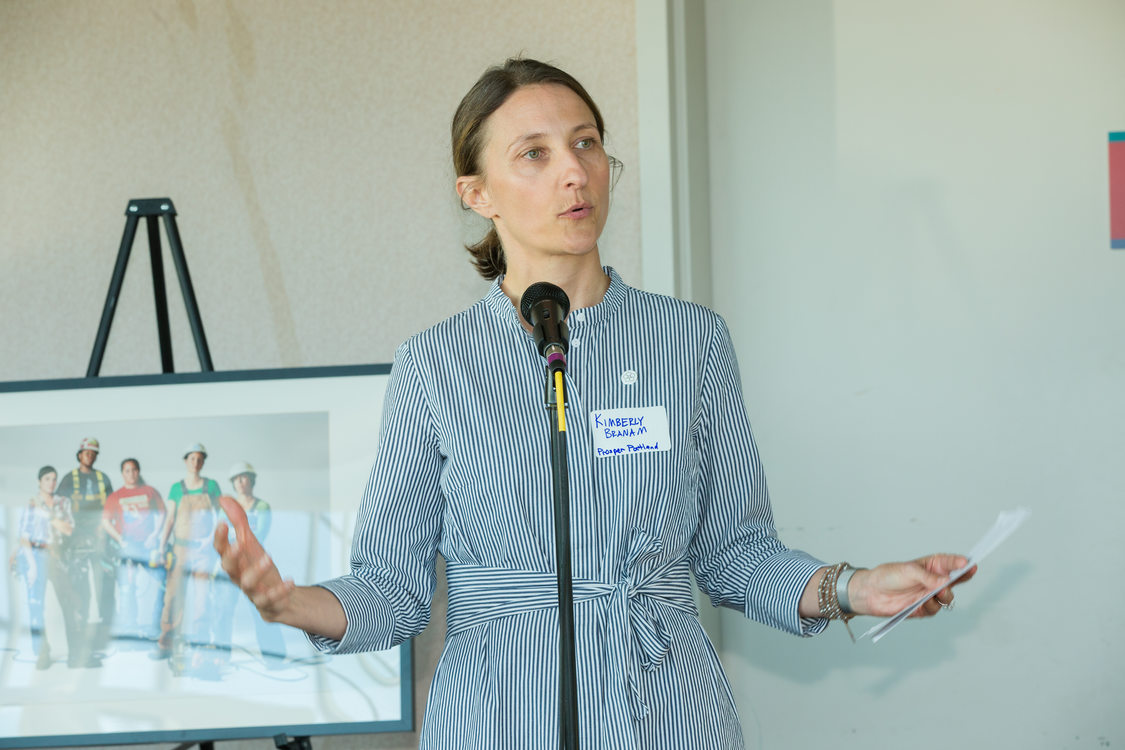 Photo of woman speaking at microphone