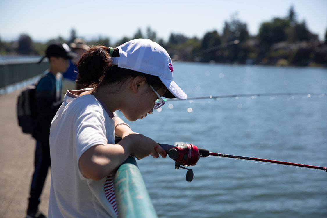 A Korean exchange student fishing at Blue Lake Regional Park