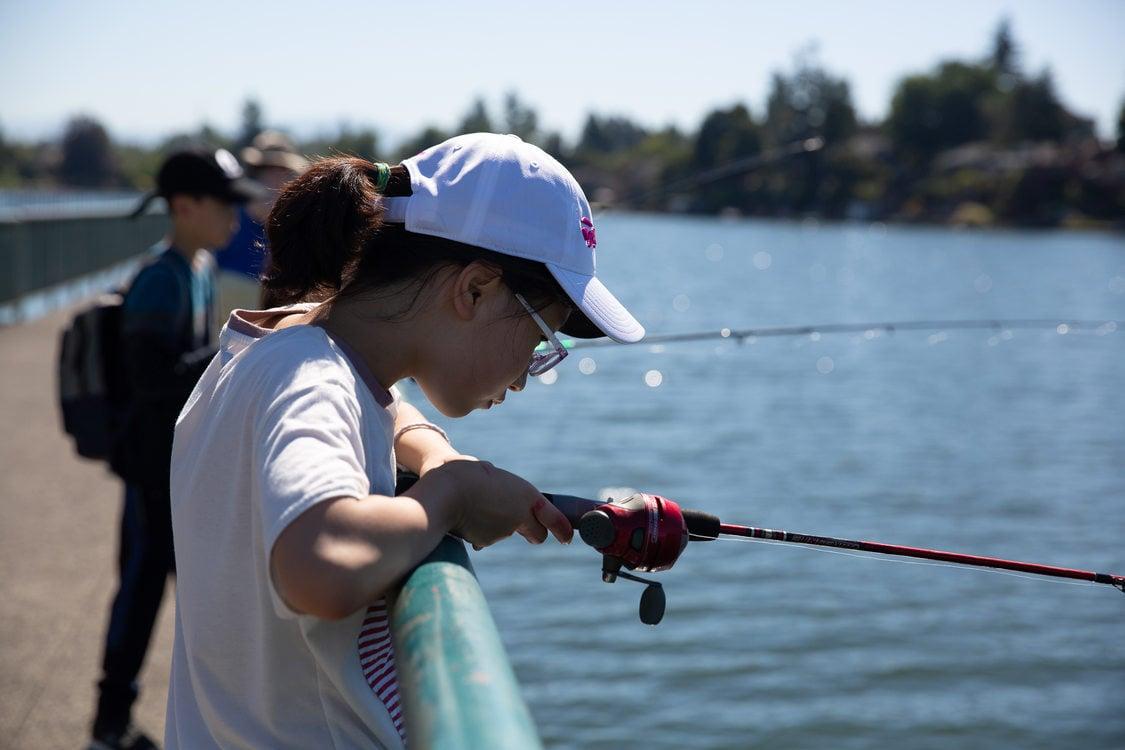 A Korean exchange student fishing at Blue Lake Regional Park