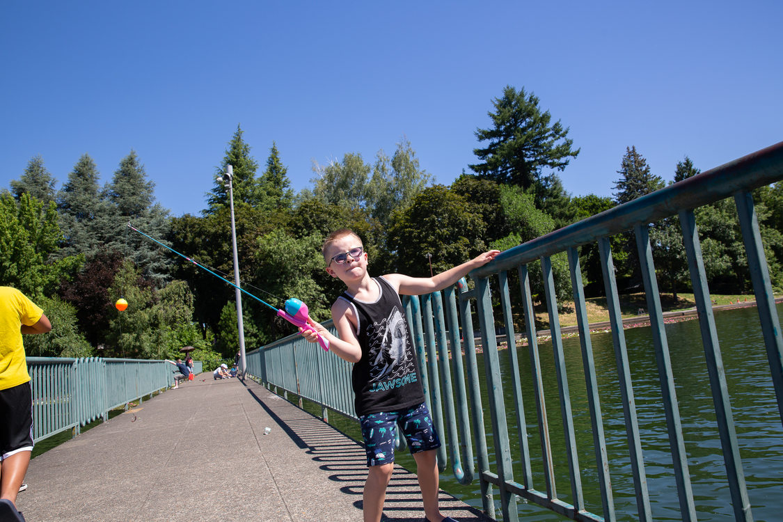 A boy fishing from the pier at Blue Lake Regional Park
