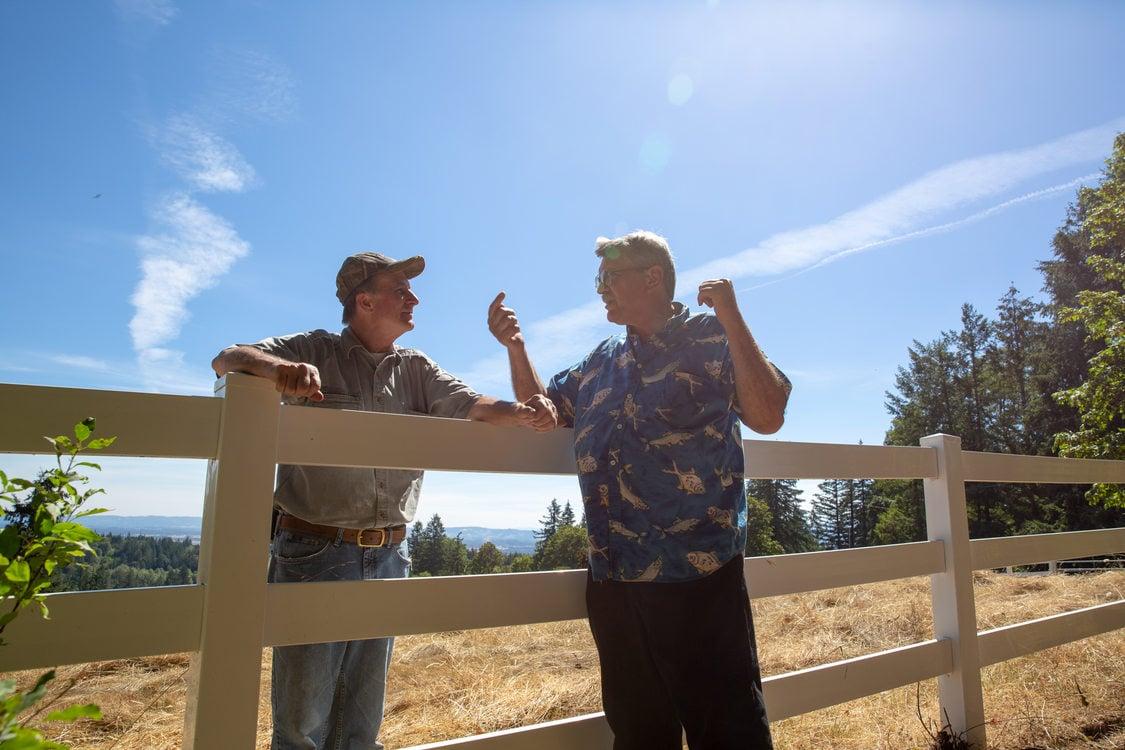 Jim Carlson and Bruce Ellis have a conversation at Mason Hill