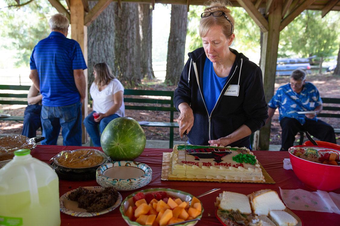 Joy Johnson cuts a 65th anniversary Mason Hill picnic cake
