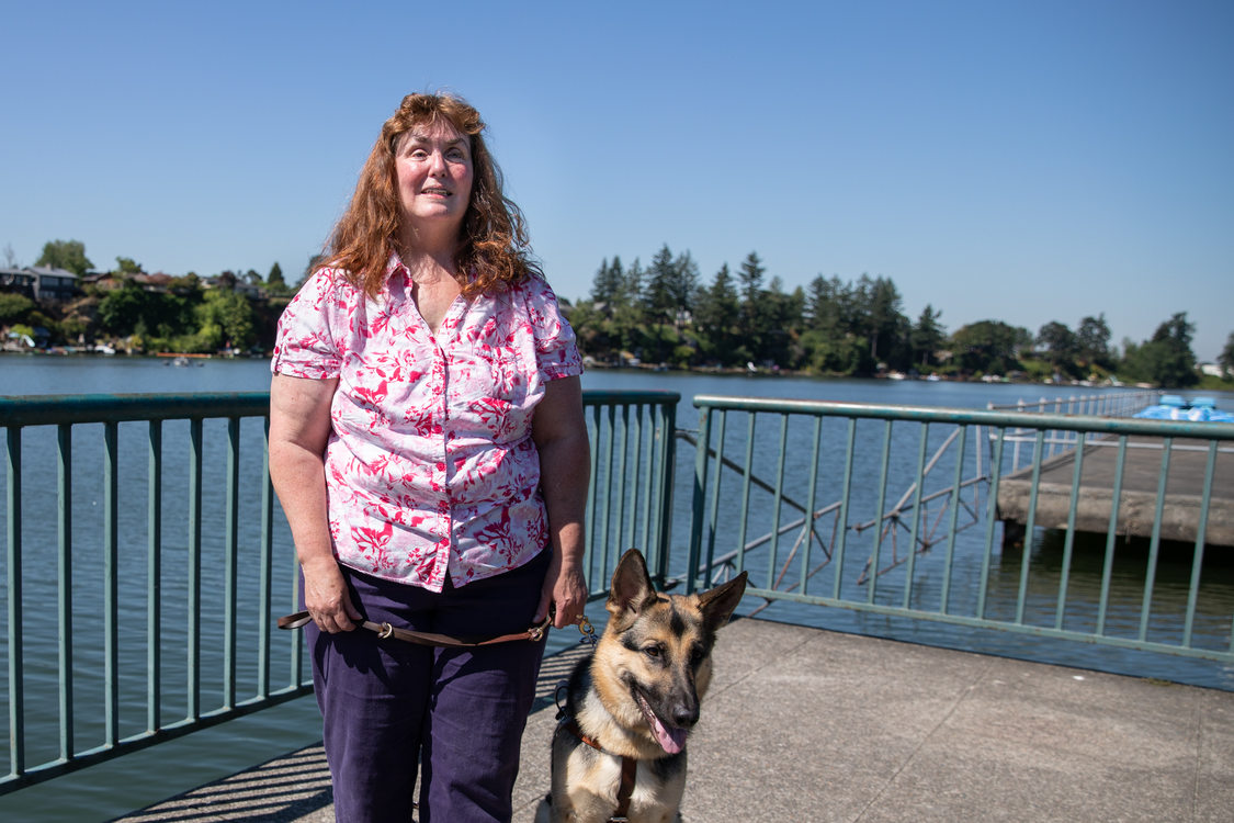 Patricia Kepler with her guide dog on the fishing dock at Blue Lake Regional Park