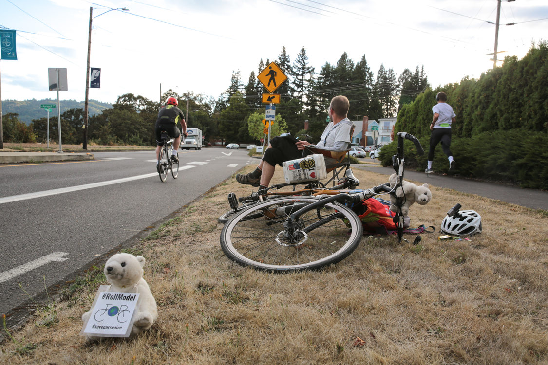 Volunteer Philip Fensterer counts passing cyclists and pedestrians on Willamette Boulevard