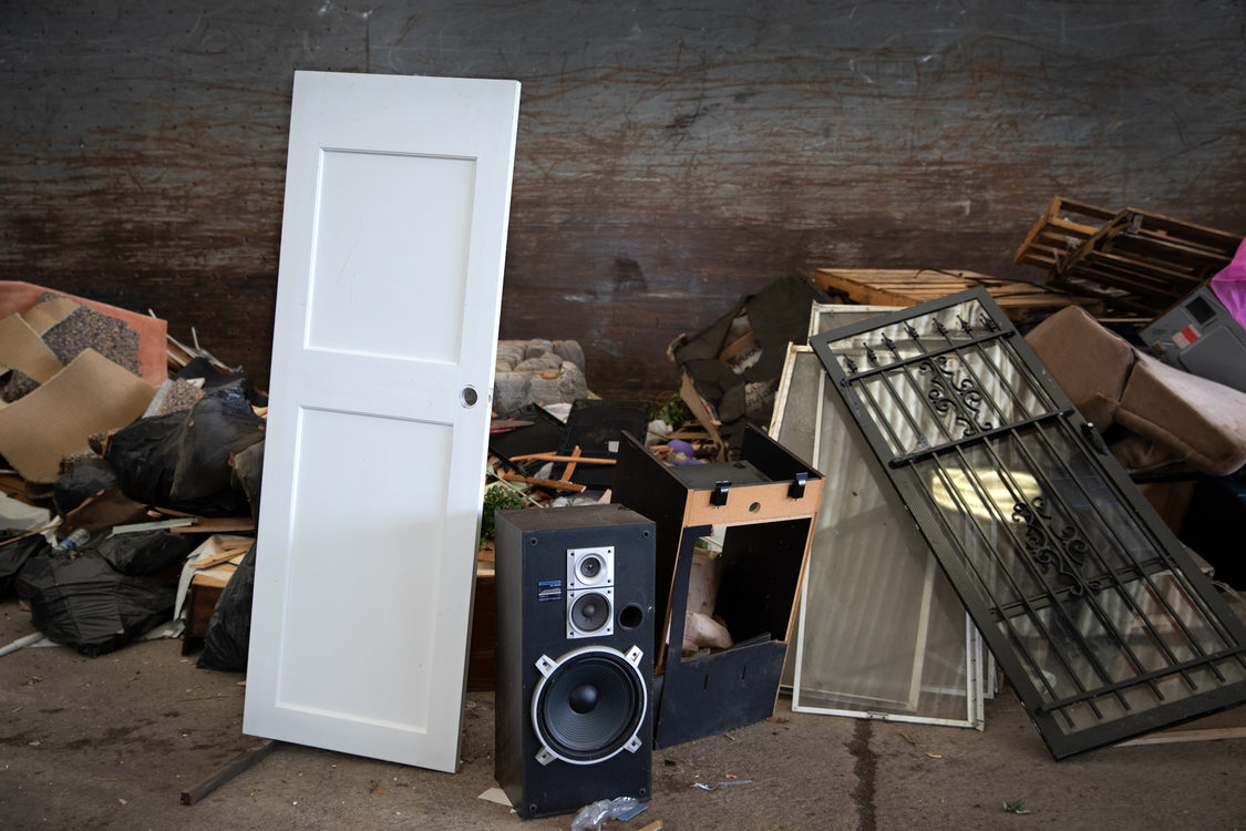 a wooden house door and stereo speakers join the pile to be sorted at Metro Central