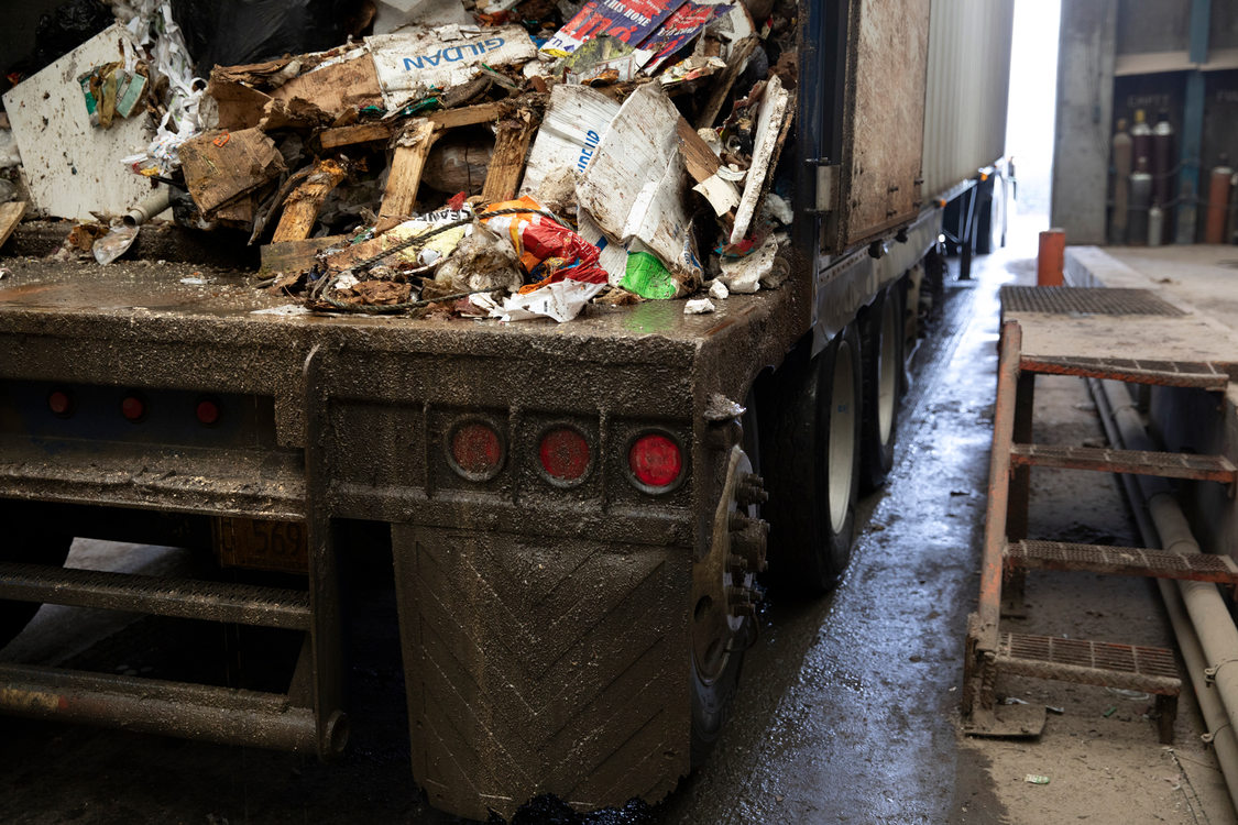 view of the inside of a truck trailer full of garbage