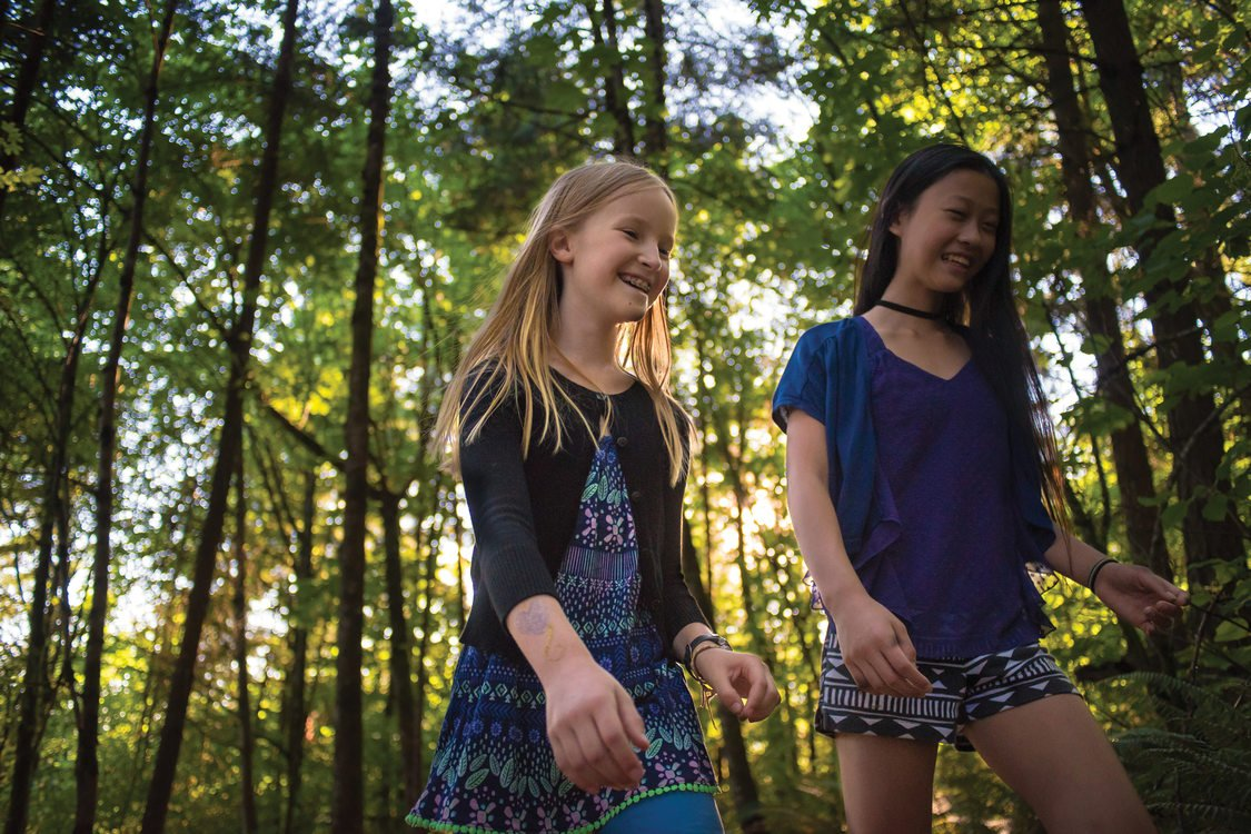 Claire Dolan and Madelyn Joe hike at Mount Talbert Nature Park.