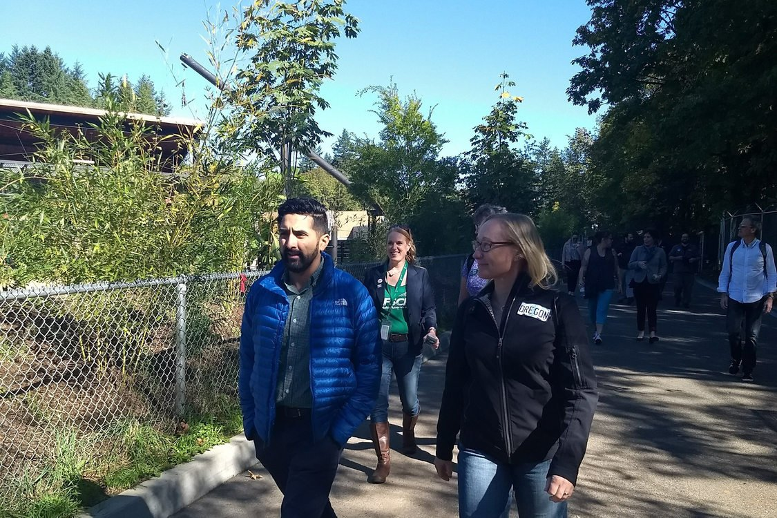 Metro Council President Lynn Peterson and Councilor Juan Carlos Gonzalez walking through Oregon Zoo