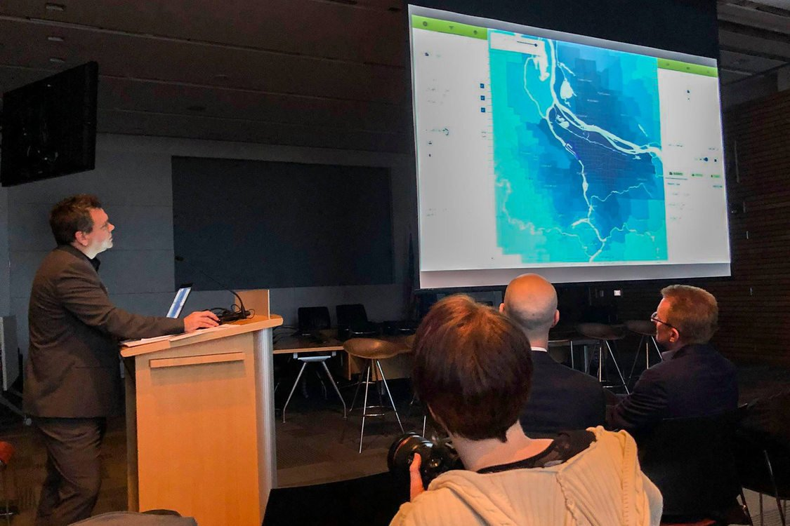Metro's Jeffrey Raker presents how the economic value atlas tool works to an audience at the launch party in December.