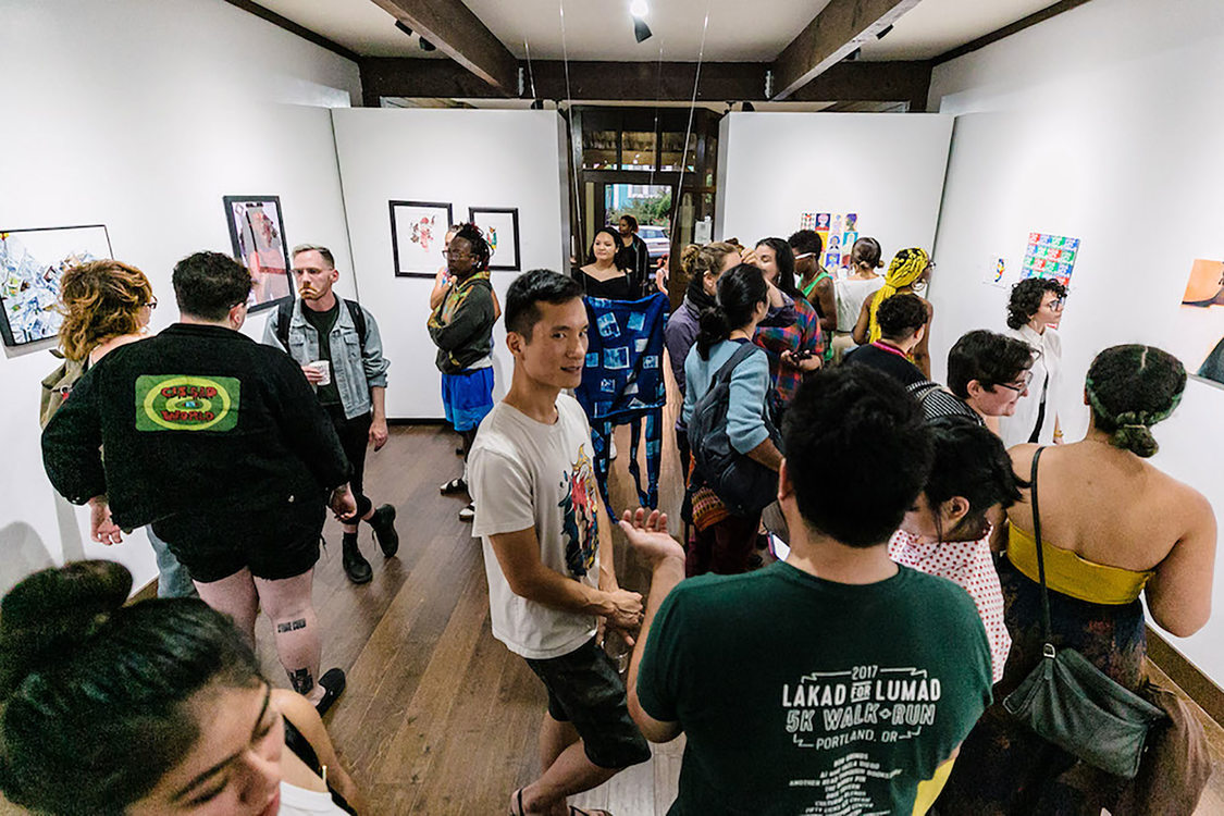 an art gallery full of people