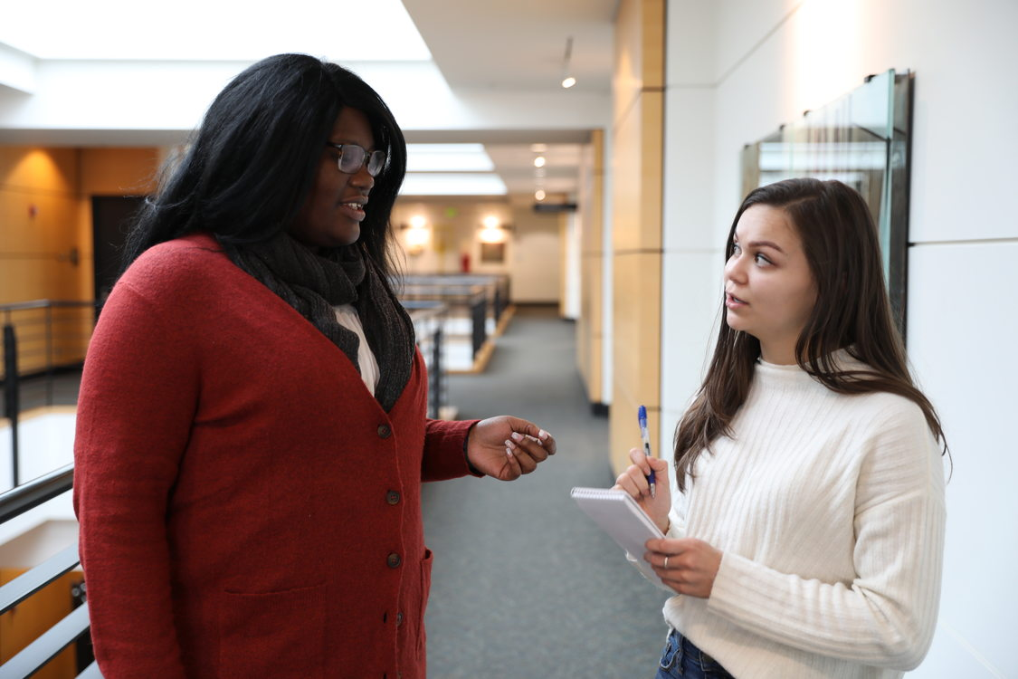 woman interviewing another woman at Metro Regional Center