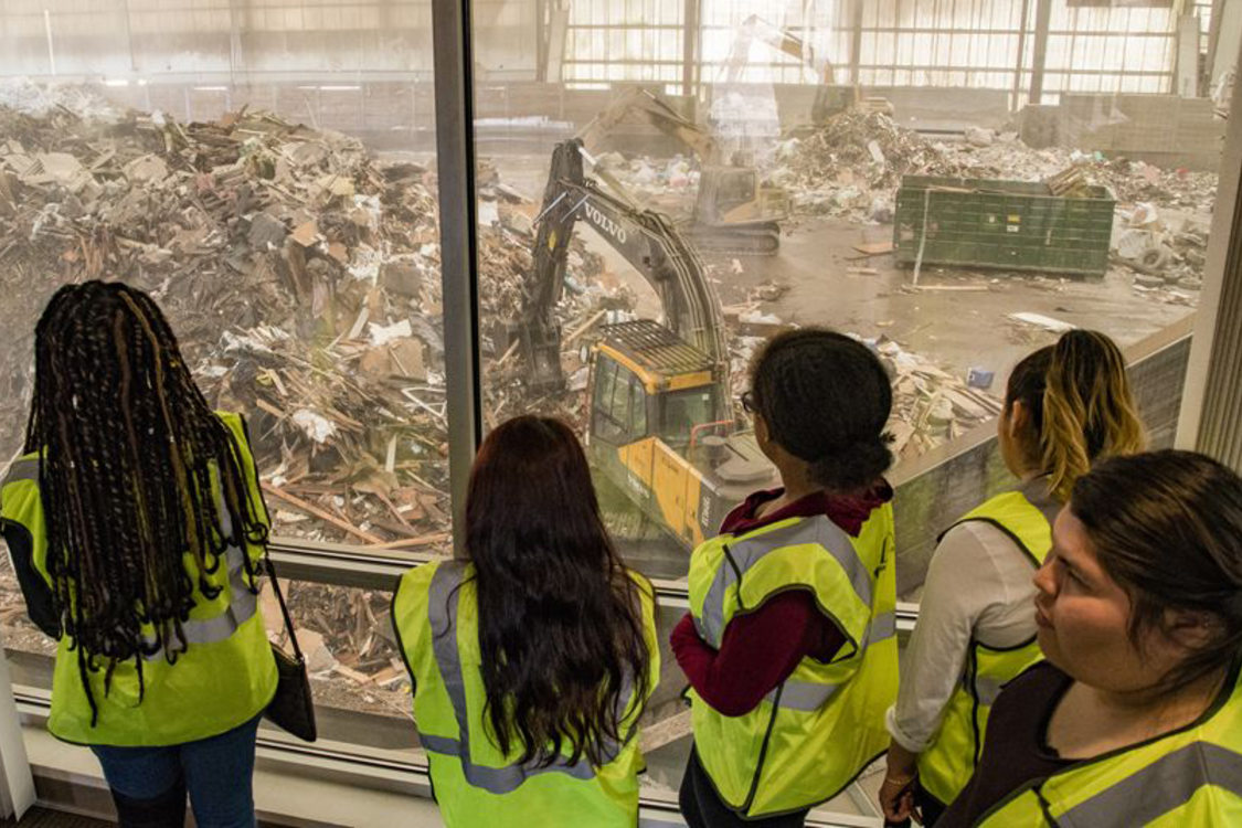 garbage and recycling interns touring a transfer station