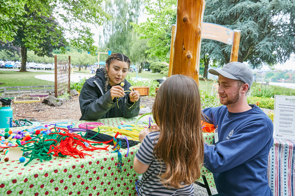 child making crafts at a table in Blue Lake Discovery Garden