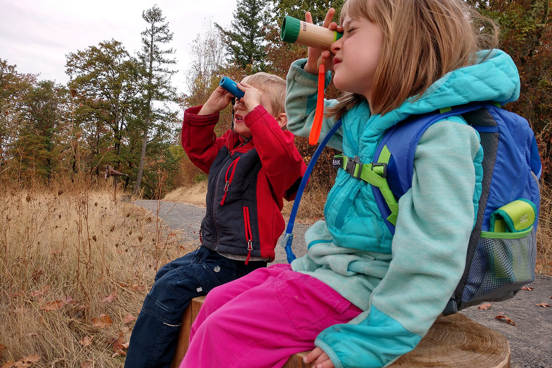 Two children look through spyglasses at Cooper Mountain Nature Park.