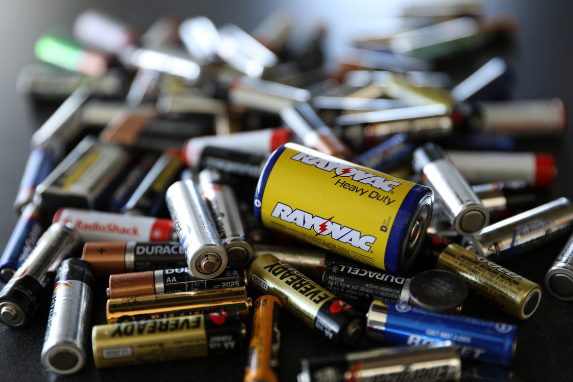 pile of batteries of varying sizes and types for disposal