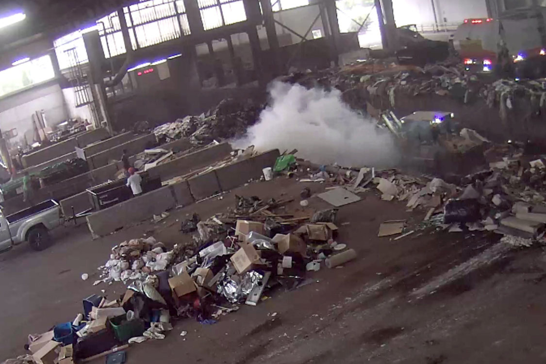Smoke billows from the trash pit at Metro South transfer station