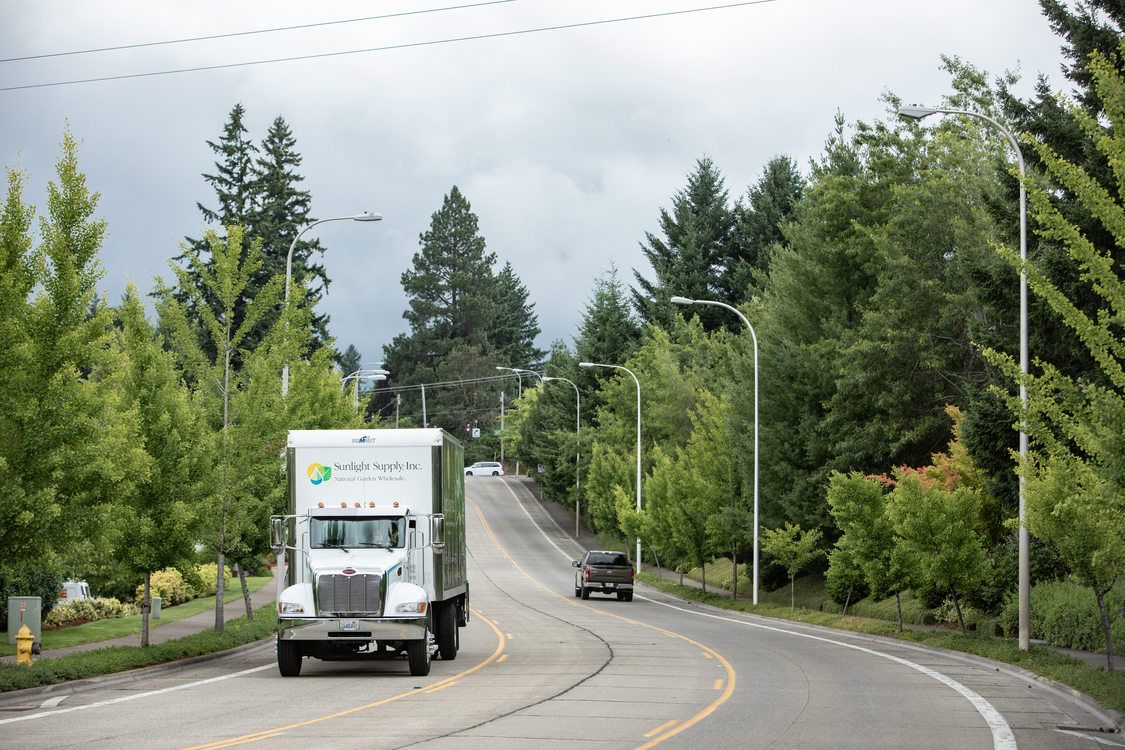 large truck drives on a road in Wilsonville