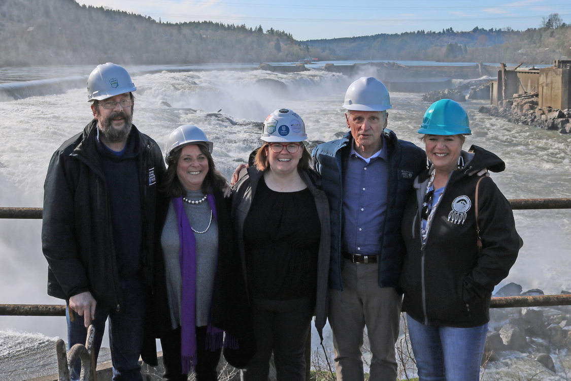Metro Councilor Christine Lewis stands with other elected officials in front of Willamette Falls in Oregon City