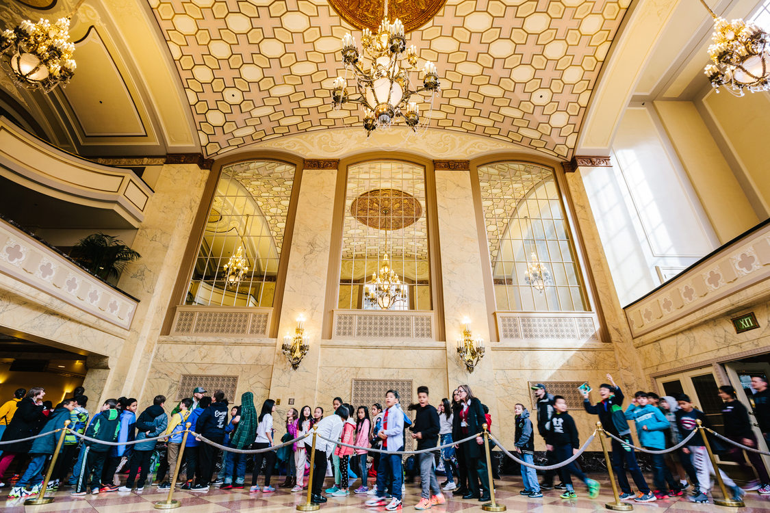 A group of youth listen to the band Mariachi del Sol in the Arlene Schnitzer concert hall