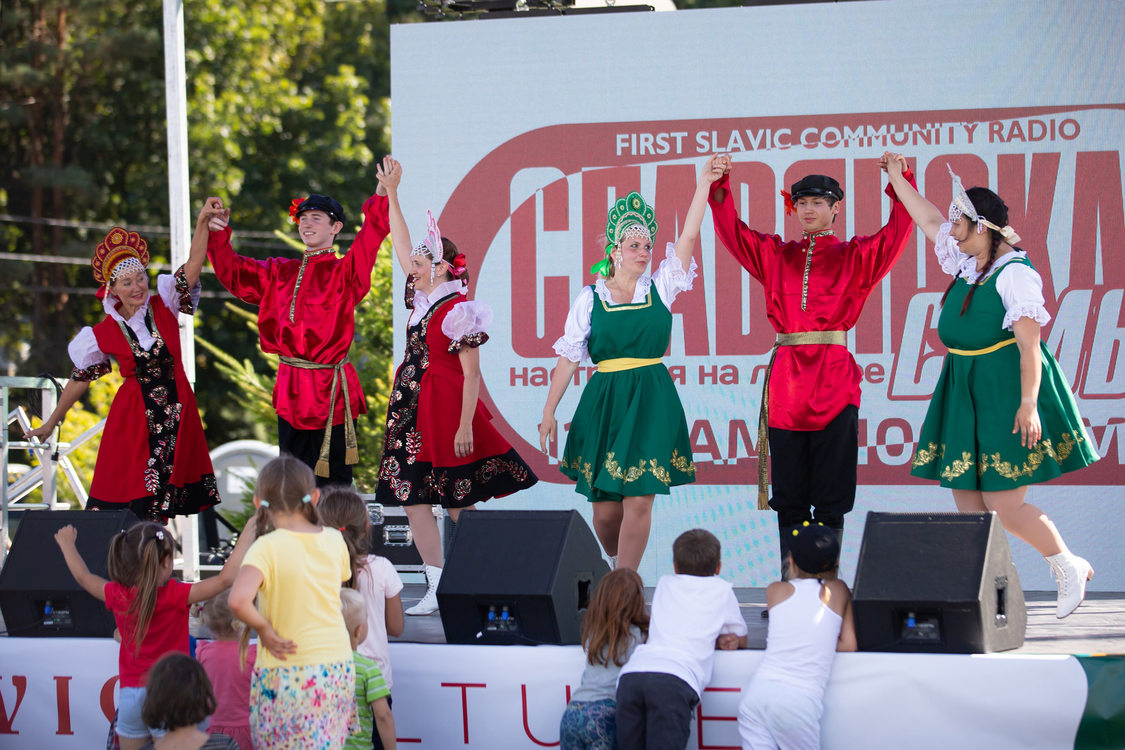 performers in brightly-colored clothing on a stage at the 12th annual Slavic Festival