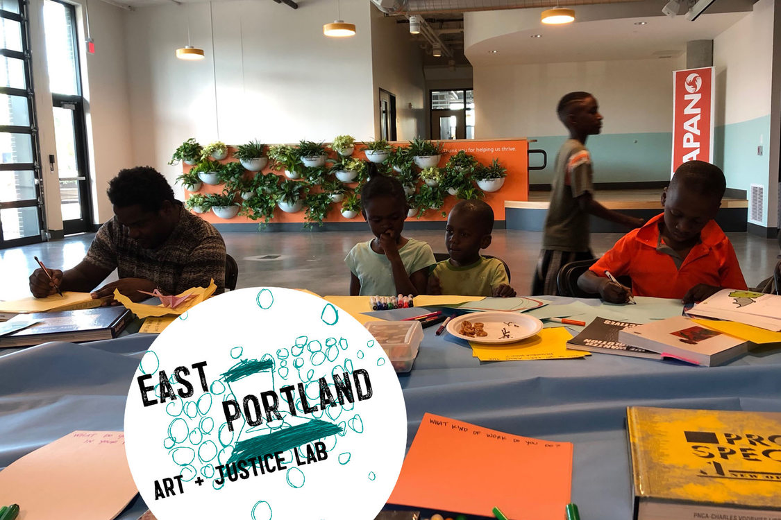 youth seated around a table at APANO working on the East Portland Art + Justice Lab program