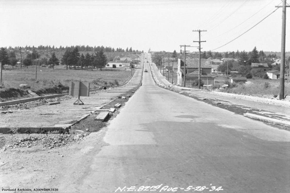 a black and white photo of 82nd Avenue in 1934 with no development