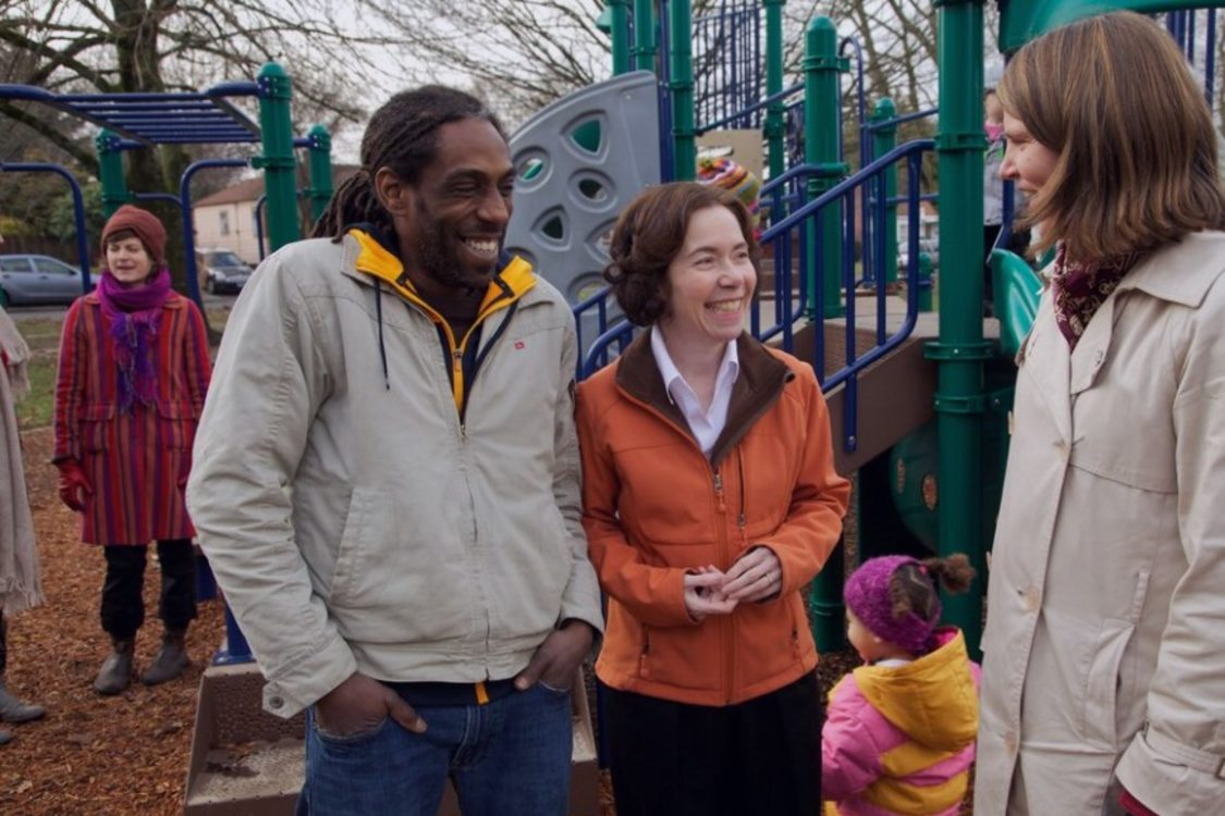 Metro Councilor for District 5, Mary Nolan speaks with community members in a park playground