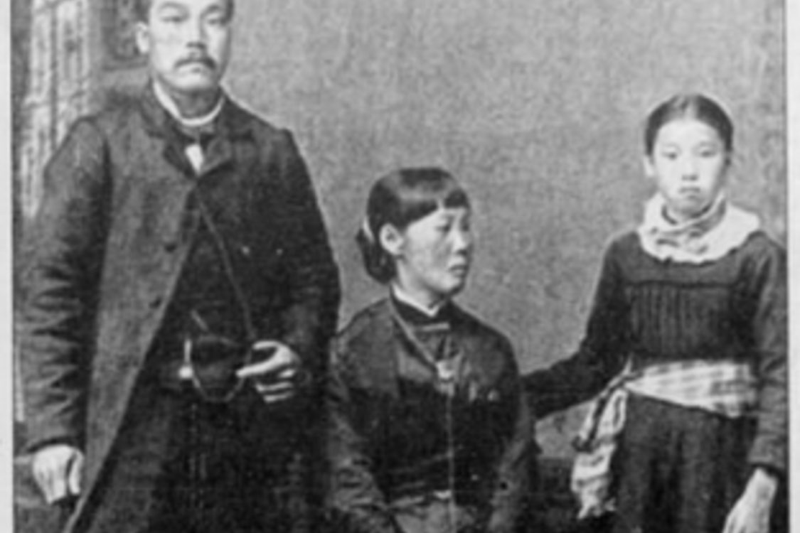A photo from 1886 of three Japanese Americans wearing formal clothing.