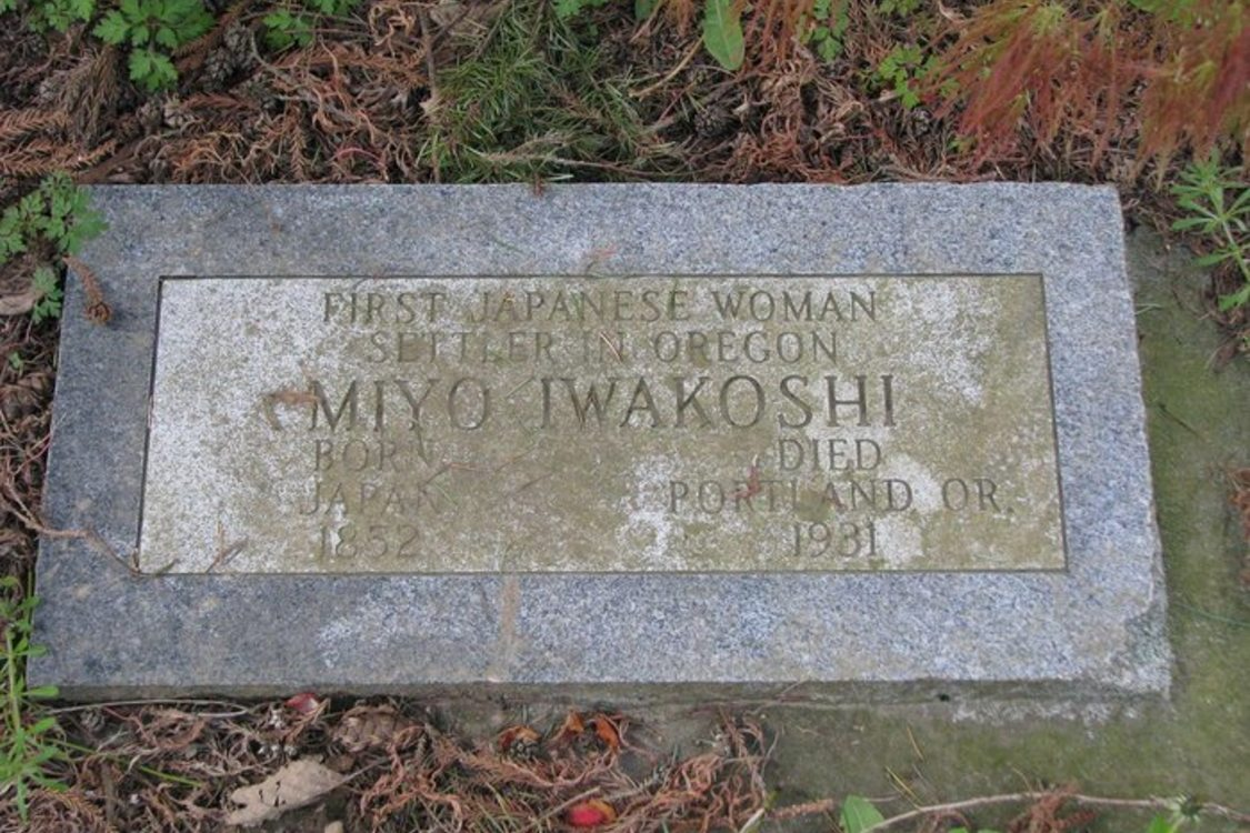 A headstone covered with dirt.